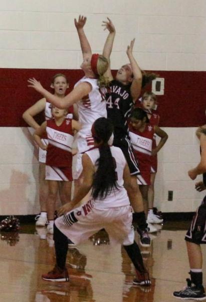 HS girls fighting for rebound