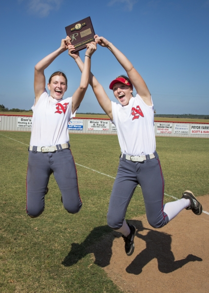 Two girls holding a Softball Plaque